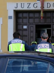 Spanish suspect Miguel Angel Munoz arrives at the Court