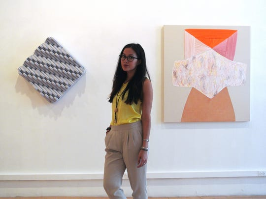 Christina Papanicolaou is the curator and director of E.TAY Gallery. Originally from Monmouth County, she is shown at a previous exhibition at the gallery in between works of Amanda Martinez (left) and Amanda Valdez.