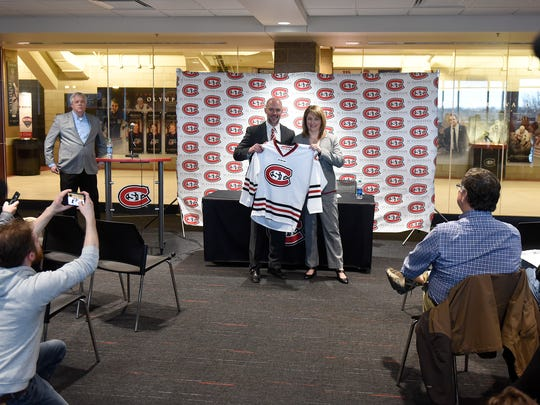 New St. Cloud State University Men's Hockey Coach Brett Larson holds a hockey jersey with athletics director Heather Weems during a press conference Friday, April 13, at the Herb Brooks National Hockey Center in St. Cloud.