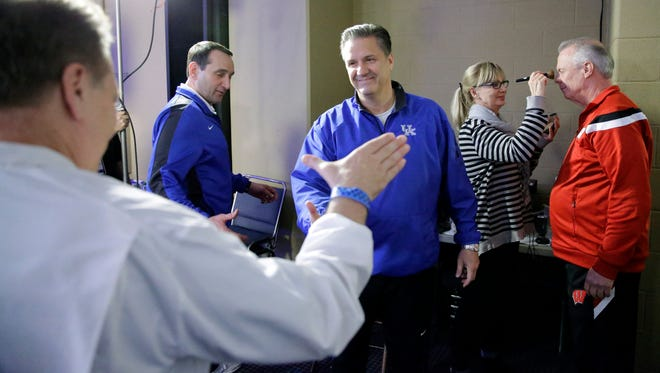 Michigan State head coach Tom Izzo, Kentucky head coach John Calipari, Duke head coach Mike Krzyzewski and Wisconsin head coach Bo Ryan get ready for a CBS Sports interview for their NCAA Final Four tournament college basketball semifinal game Thursday, April 2, 2015, in Indianapolis.