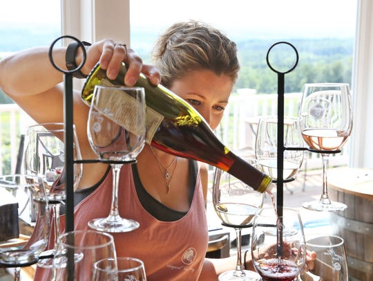 Nikki Folts, owner Vineyard View Winery, pours a wine