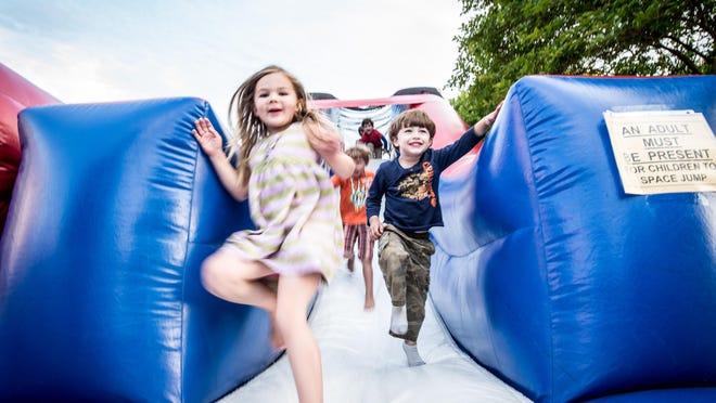 Arts, Eats & Beats includes a kids' area with a bounce house.