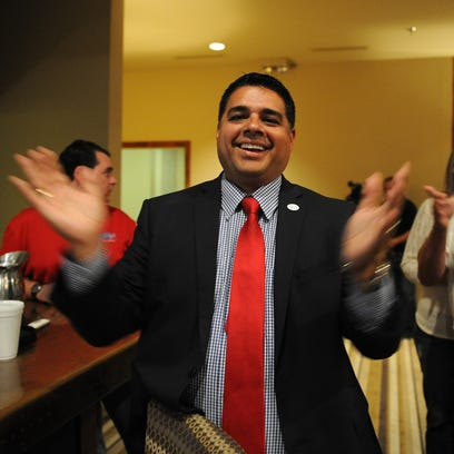 Stephan Santellana claps after the early voting results