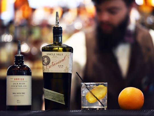 Bartender Brandon Lee prepares the Best Damn Gin &