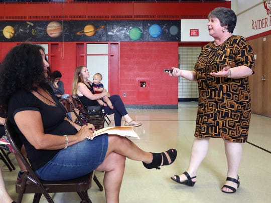 North Rockland School Superintendent Ileana Eckert talks to parents attending a lottery to place their children in full day kindergarten at the District offices in Garnerville July 10, 2017.