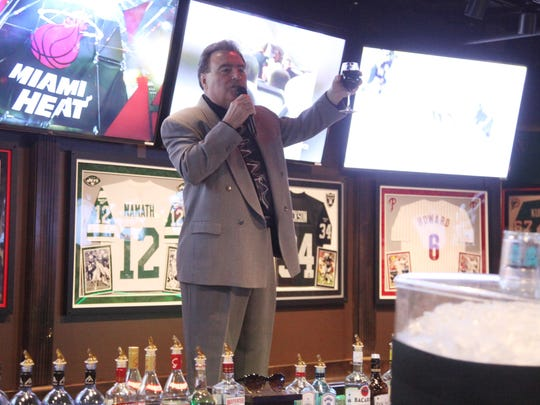 John Carioscia proposes a toast during a private party at Duffy's Sports Grill after winning the Cape Coral City Council District 2 seat.