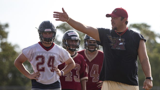 Ashley football coach Wilson Helms addresses his team during the first official day of football practice in 2019. Helms and other fall sports coaches in the area remain in limbo for when they can start summer training in advance of the 2020-21 school year.