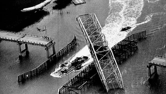 A ferry plies the Intracoastal Waterway by the Ben Sawyer Bridge at Sullivan's Island on Sept. 28, 1989, after the bridge was damaged by Hurricane Hugo.