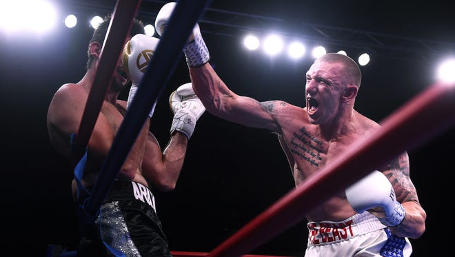 U.S. Army Veteran Blake ÒThe BeastÓ McKernan, right, attacks MexicoÕs Daniel Arambula during The Main Event boxing at the Reno-Sparks Convention Center in Reno on May 4, 2018.