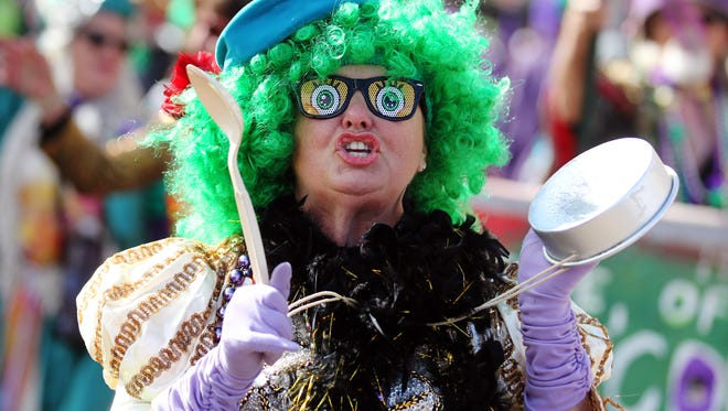 A member of the Krewe of Cous Cous bangs a pan during the 2015 Lafayette Mardi Gras  KADN/KLAF Independent Parade in Lafayette, Tuesday, February 17, 2015.