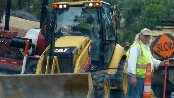 Village crews focus on one of the frequent water line breaks.