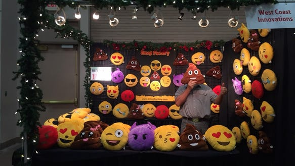 A vendor is seen with his Emoji Pillows at the Junior