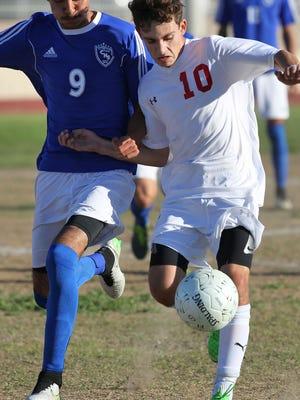 Leonardo Garcia-Guerra, 10, dribbles upfield for Palm Desert High School during their loss to Century, February 19, 2016.