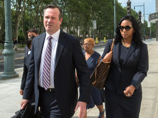 Defense attorney Edward O'Callaghan and Kendra Gamble-Webb leave the courthouse following the arraignment of former FIFA official Jeffrey Webb in Federal Court in Brooklyn on racketeering and bribery charges Saturday, June 18, 2015, in New York. (AP Photo/Bryan R, Smith)