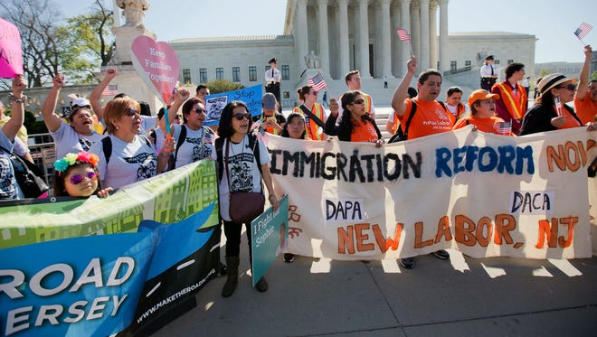 In this April 18, 2016 photo, supporters of fair immigration reform gather in front of the Supreme Court in Washington. Republican presidential candidate Donald Trump's aggressive rhetoric on illegal immigration has obscured what may ultimately be a policy detour, the Republican presidential nominee is the first major party candidate in modern memory to propose limiting legal immigration.