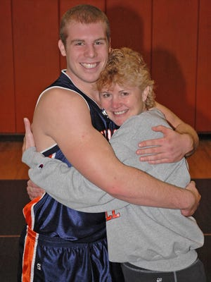 Jason Seaman hugs his mother Kristi when he was a high school basketball player in Mahomet, Ill.