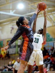 Southwood's Sheniqua Coatney, left, blocks the shot