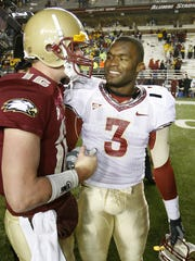 FILE - In this Nov. 3, 2007, file photo, Boston College quarterback Matt Ryan, left, congratulates Florida State's Myron Rolle after FSU defeated Boston College 27-17 in an NCAA college football game at Alumni Stadium in Boston. Rolle was an All-American defensive back at Florida State but his bigger accomplishments have come off the field. He was a Rhodes Scholar and last month graduated from Florida State's College of Medicine. Rolle begins his neurosurgery residency next month at Harvard Medical School. (AP Photo/Tallahassee Democrat, Mike Ewen, File)/Tallahassee Democrat via AP)