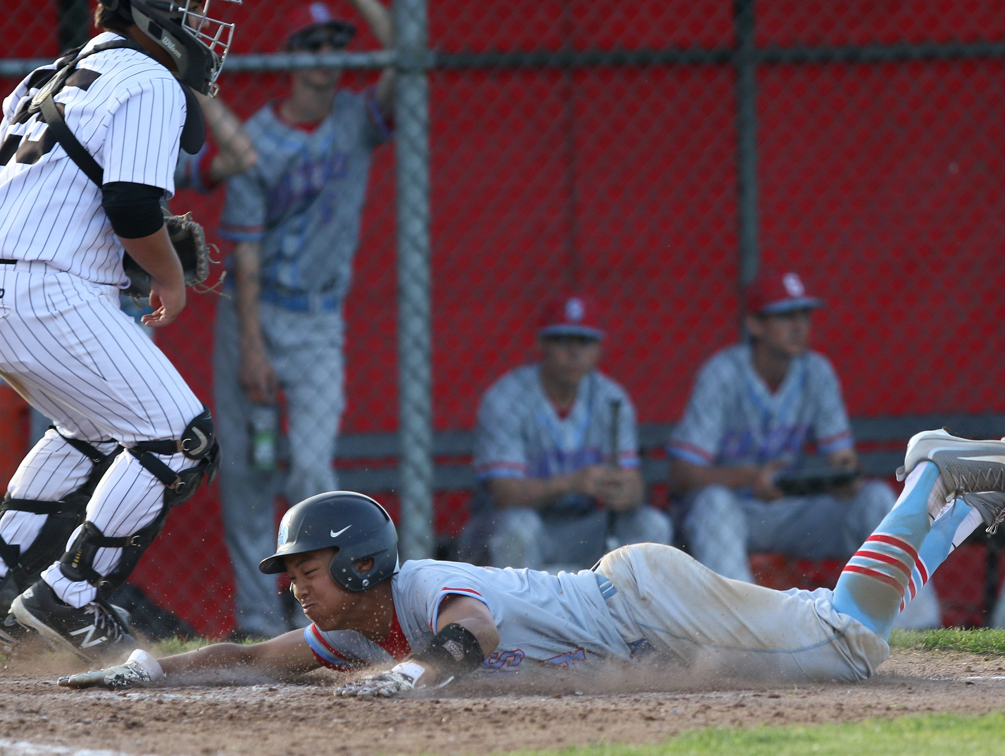 South Salem's Tony Phong slides home as the Saxons defeat North Salem 8-1 on Friday, April 8, 2016, during a Greater Valley Conference game.