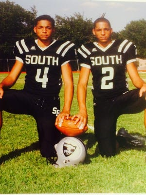 Tracin, number four and Tylan, number 2 are stand out athletes – second year varsity starters – and identical twins attending South Hills High School.