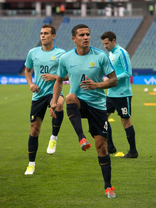 Australia's Tim Cahill, foreground and Trent Sainsbury, left take part in a training session at the Fisht stadium in Sochi, Russia, on Sunday, June 18, 2017. Australia will face Germany in a Confederations Cup, Group B soccer match scheduled Monday, June 19, 2017. (AP Photo/Artur Lebedev)
