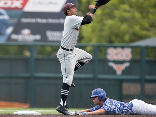 Sinton's shortstop Jordan Martinez jumps throw to second base as Robinson's Mason Cooper slides in to second during the second inning of the Class 4A State Semifinal at Disch-Falk Field in Austin on Wednesday, June 7, 2017.