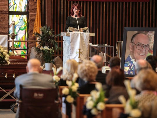 Tamara Cobbin speaks at her father's funeral service