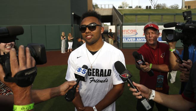 Texas A&M's Christian Kirk talks to the press before the Larry Fitzgerald Celebrity Softball game at Salt River Fields in Scottsdale, Ariz. on April 21, 2018.