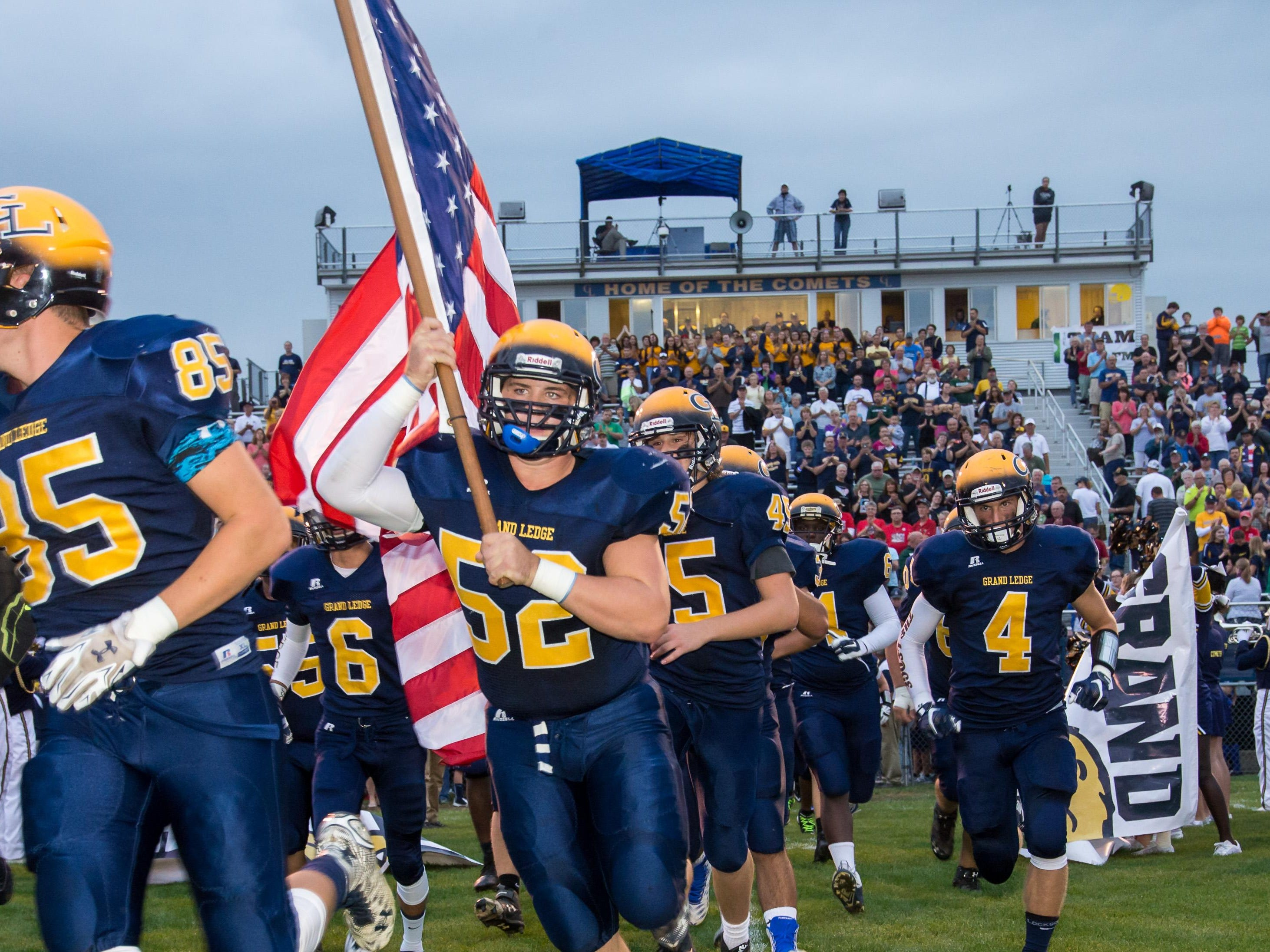 """Grand Ledge players take the field prior to their """"Fallen Heroes"""" game Friday."""