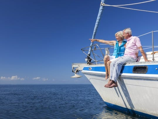 senior-couple-sitting-on-sailboat_large.jpg