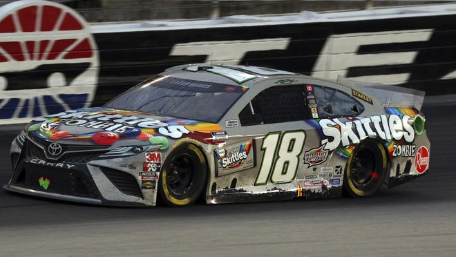 Kyle Busch heads out of Turn 4 onto the front stretch at Texas Motor Speedway on Wednesday.