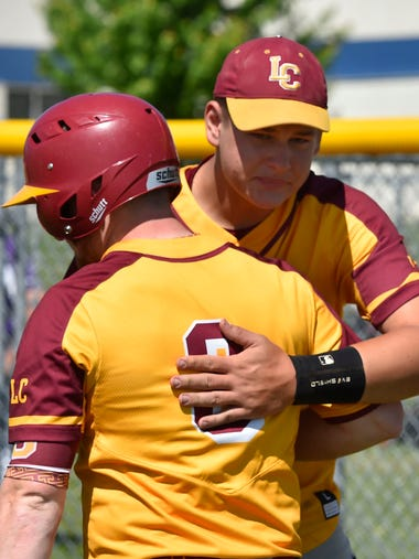 Seniors Austin Tlachac, left, and Jared Hudson console