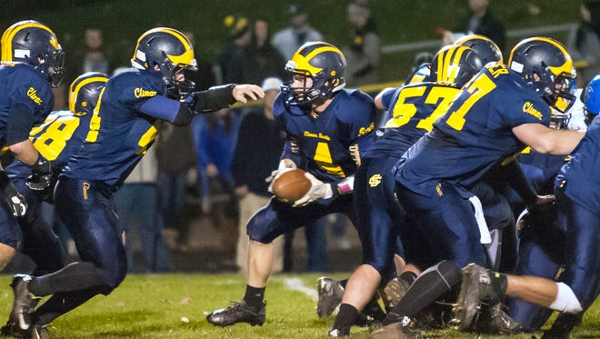 Climax-Scotts quarterback Dylan Butler prepares to hand the ball off to running back James Behlke late in the second quarter of play Friday night.