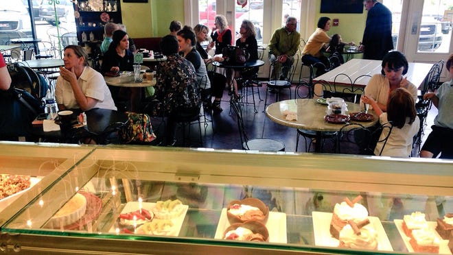 Customers filled Indulge Dessert Lounge Tuesday evening as Food Network film crews shot for an upcoming television show featuring Paula Deen's sons.