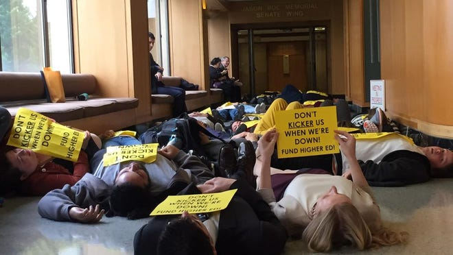 Students protest the kicker and call for high funding of post secondary education.