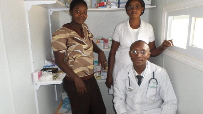 Dr. Daniest Adrien runs the clinic with help from nurses Rose-Emmanuel Eloi (left) and Gentilia Louis (right).
