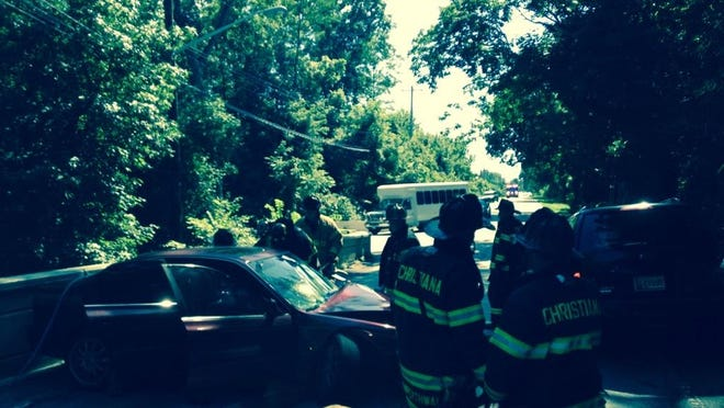 Emergency responders respond to a crash at Old Baltimore Pike and Old Cooches Bridge Road for a two-vehicle crash Friday, July 31, 2015.
