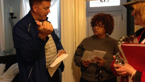 Michael Smith, volunteer with Big Brothers Big Sisters of York and Adams Counties, details fire safety protocol with Vilisha Barnes after volunteers installed a new smoke detector at Barnes' home in the 500 block of West King Street. (Mark Walters - Daily Record/Sunday News)