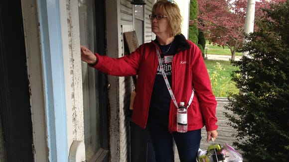 Kerri Cassel was one of nearly 80 volunteers who canvassed York's Salem Square neighborhood Thursday during a home fire prevention campaign. Cassel, who works for CGA Law Firm, wanted to get involved with the York community, so she joined one of her coworkers in the campaign that aimed to install 1,000 free smoke detectors inside homes that needed them. (Mark Walters - Daily Record/Sunday News)