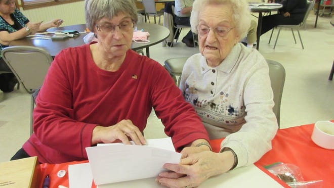 Joyce Henion and Elsie Farmer going over some of the details of the upcoming Holiday Bazaar being held at The Center. provided photo