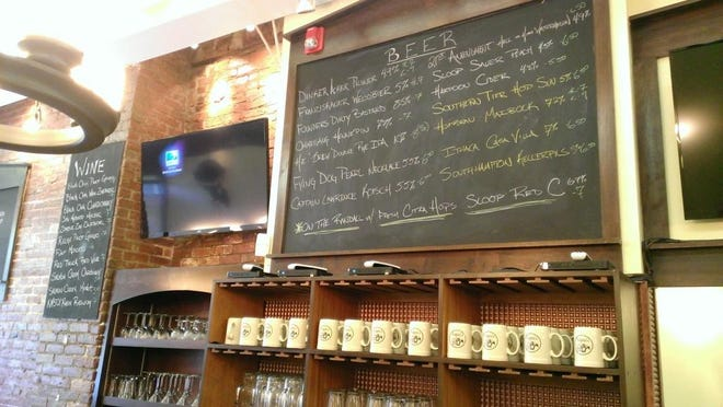 The beer selection is displayed above the bar at Schatzi's.