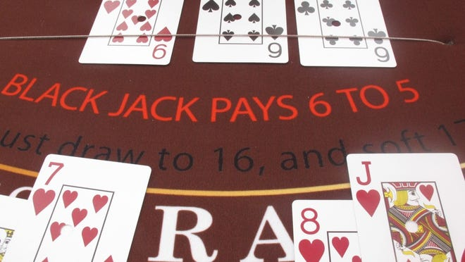This Sept. 5, 2012 photo shows cards on a blackjack table at the Golden Nugget casino in Atlantic City, N.J.  (AP Photo/Wayne Parry)