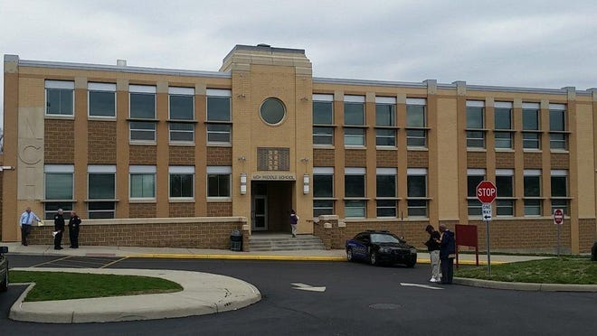 Police search North College Hill school buildings Wednesday after bomb threats.