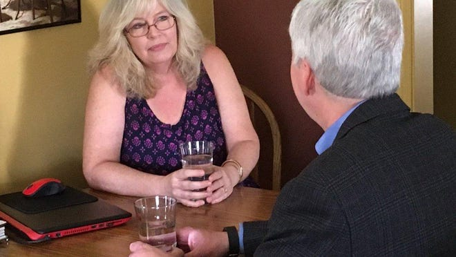 Gov. Rick Snyder visited the home of Flint resident Cheryl Hill that is part of the state's sentinel site testing program. The governor filled up on tap water there.
