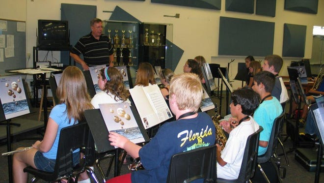 In this file photo, Art Martin, coordinator of Melbourne Municipal Band's free Summer Youth Band Music Program, directs a session during a prior summer.