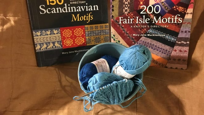 Here are Mary Jane Mucklestone's books of Fair Isle and Scandinavian charts, along with the beginning of my alpaca hat and the 3 skeins of co-op alpaca yarn I'm using.