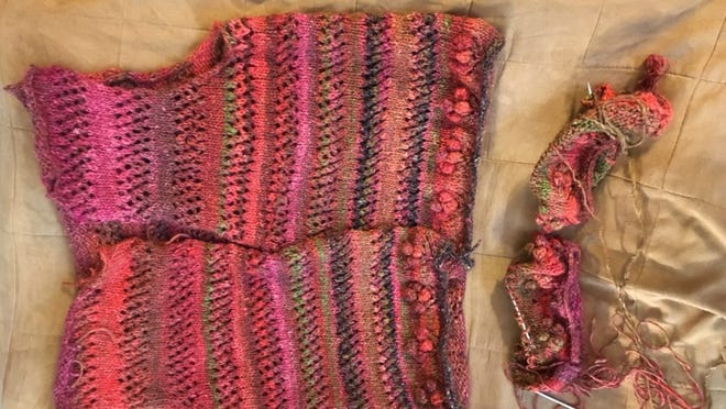 This is a sideways view of the current state of Mom's Noro sweater. The body is knitted, though I have to sew the shoulders and knit the button plackets/collar. Aoso, I didn't line the fronts up, but the stripes do match pretty well. The sleeves are started, though you may think that because I placed them so close together, they are one continguous piece. They are not.