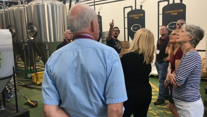 "OLLI members learn about the fermentation process in ""Brewing a Sustainable Small Business: Exploring the Craft Beer Industry,"" taught by Gabriel Grass (rear), owner of Grasslands Brewing Company."