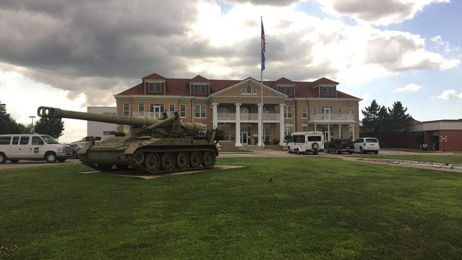 A retired military tank stands watch in front of the Oklahoma Veterans Center in Ardmore. Delays in receiving vaccinations from federal stockpiles led state lawmakers, VA officials, and state health department officials to allocate vaccines for the Ardmore facility from state resources.