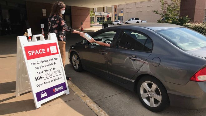 As a way to maintain social distancing the Shawnee Public Library now offers curbside pick up for patrons to pick up their books, movies and other items.